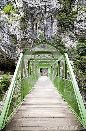 Wood bridge or walkway through the mountain