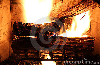 Wood buring in the fire place.