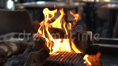 Wood burning for grilling sausages and steak stock video footage
