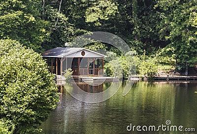 Wood Cabin on Calm Green Lake