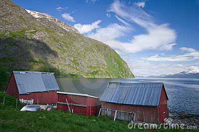 Wood cabins and fjord
