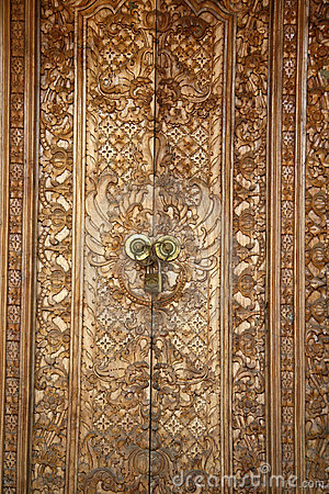 Wood carving door in bali stock photo image of wealth for Wood carving doors hd images