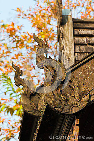 Wood carvings adorn the roof.