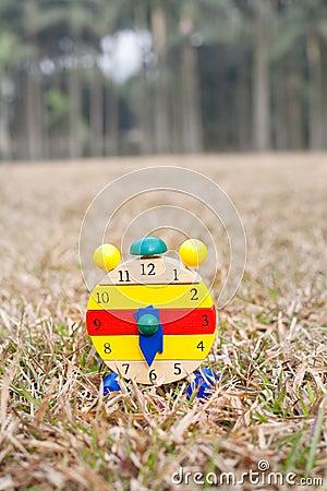 Wood clock on grass