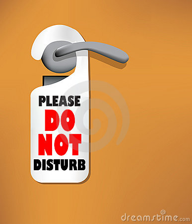 Wood door with a Do not disturb sign