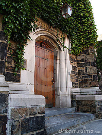 Wood door and ivy covered stone building