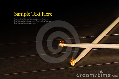 Wood Drumsticks with Tips on Fire
