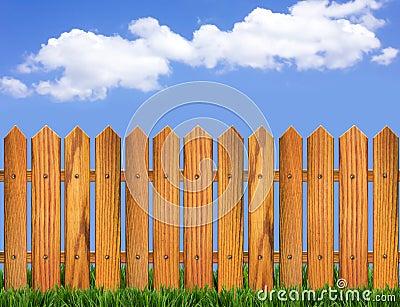 Wood fence and blue sky horizon