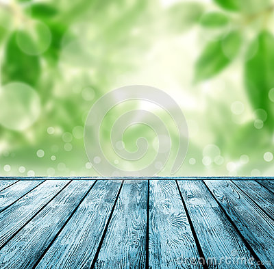 Wood floor with green bokeh .