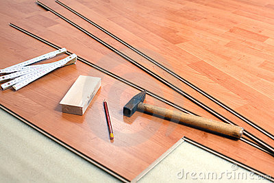 The wood flooring and tools. - Wood Flooring And Tools Royalty Free Stock Image - Image: 12111176