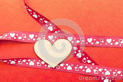 Wood heart with gift ribbon