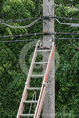 Free Wood Ladder Against Power Pole Stock Photography - 119893162