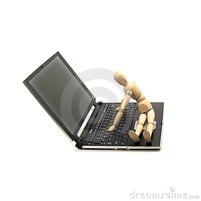 Wood mannequin and laptop