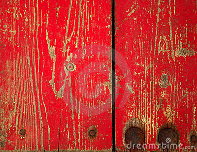 Wood panel with chipped red paint. Grunge Style