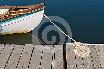 Wood Skiff Tied At Dock with Flemish Coil