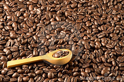 Wood spoon on coffee beans