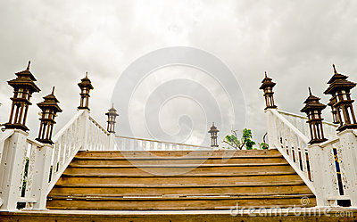 Wood stair over gray sky