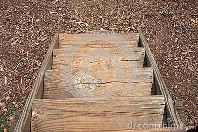 Wooden stairs on the ground