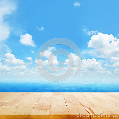 Free Wood Table Top On Blue Sea Water And Bright Summer Sky Background Stock Photos - 53858983