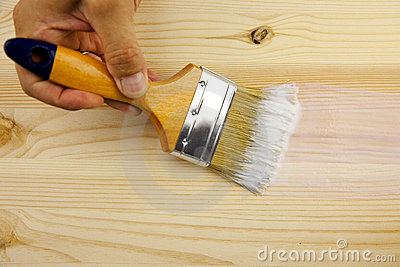 Wood texture, hand and paintbrush