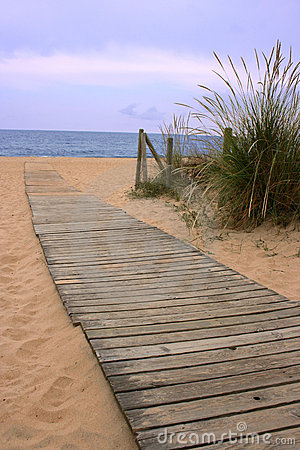 Wood walkway to the ocean