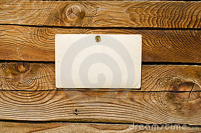 Wood wall with blank paper for message