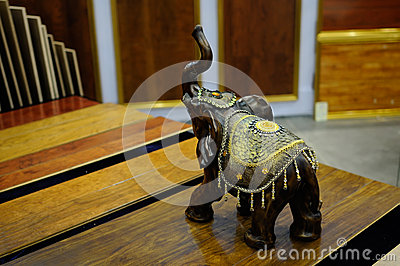 Woodcarving elephant on table
