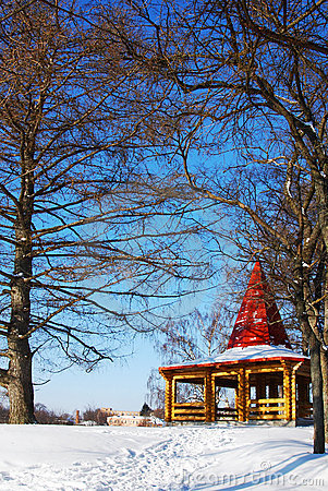 Wooden arbor in park in the winter