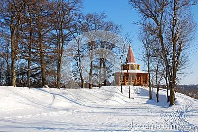 Wooden arbor in park in the winter