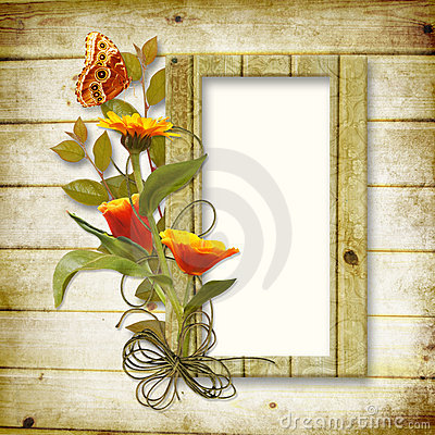 Wooden background with a frame for a photo and a b