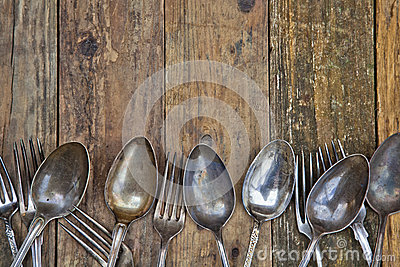 Wooden background with old cutlery