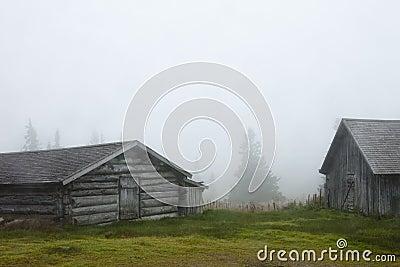 Wooden barns in fog, Sweden
