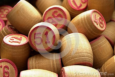 Wooden barrels with lotto games in red digits