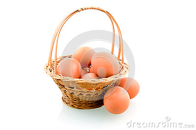 Wooden basket with chicken eggs