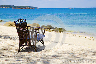 Wooden beach bench and the sea