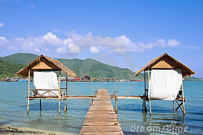 Wooden beach bungalows over water