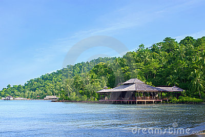 Wooden beach hotel on paradise island