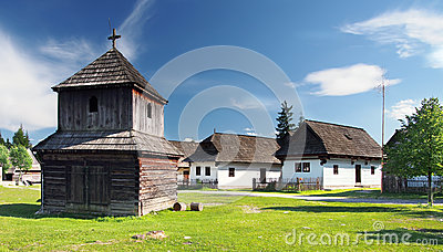 Wooden bell tower and folk houses