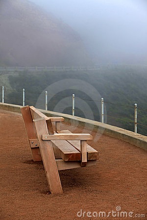 Wooden bench in a fog