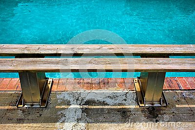 Wooden bench next to pool