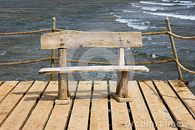 Wooden bench on the pier, seascape