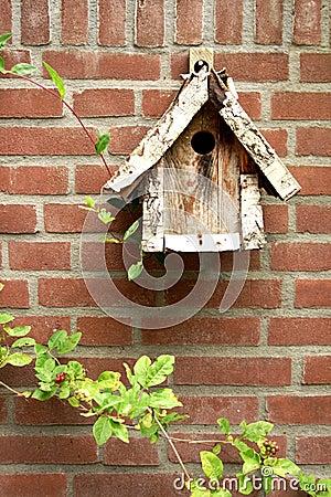 Free Wooden Birdhouse On Brick Wall Stock Photo - 2765640