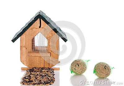 Wooden birdhouse with seeds