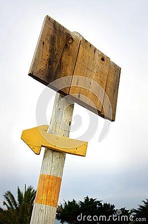Wooden placard a arrow