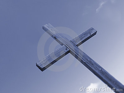 Wooden blue cross and sky