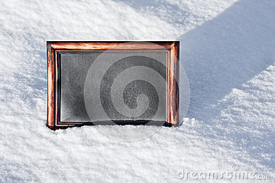 Wooden board with space for text on white snow