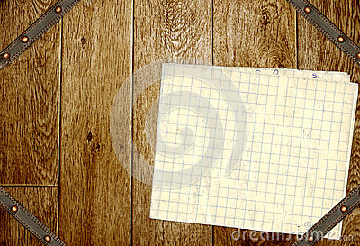 Wooden boards, old paper and leather belt