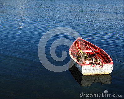 Wooden boat on blue sea