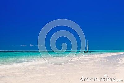 Wooden boat in crisp blue water