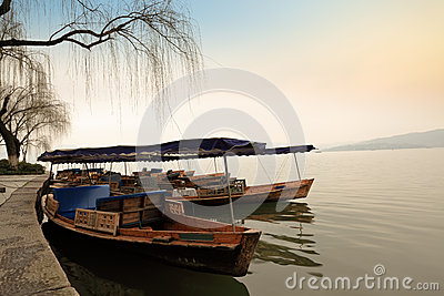 Wooden boat is docked at the shore